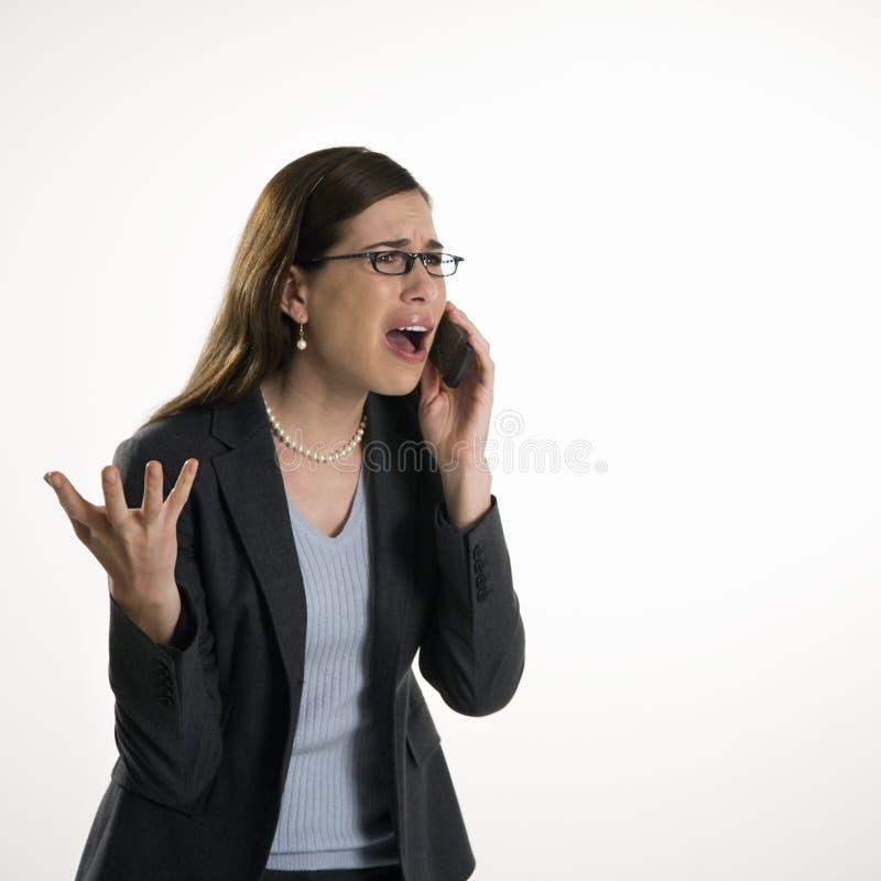 Frau auf Zelle lizenzfreie stockfotos