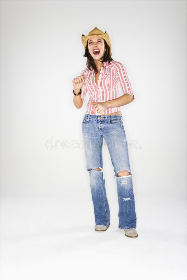 Frau beim Cowboyhutlachen. stockfoto