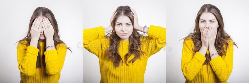 Frau in den gelben Strickjackenshows gestikuliert, um blindes taubes und stumm zu sein lizenzfreies stockbild