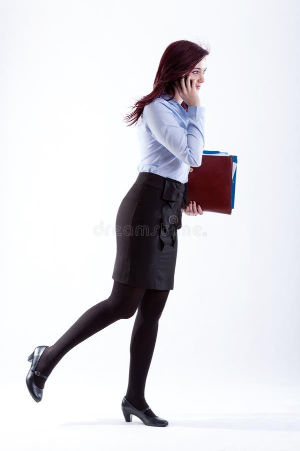 Frau in der Eile. lizenzfreies stockbild