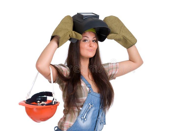 Frau in der Schweißerschablone und -handschuhen lizenzfreie stockfotos