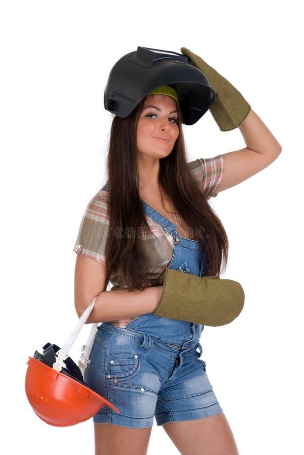 Frau in der Schweißerschablone und -sturzhelm lizenzfreie stockbilder