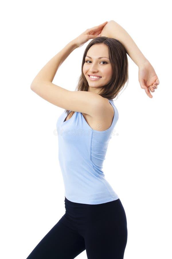 Frau in der Sportkleidung, auf Weiß stockbild