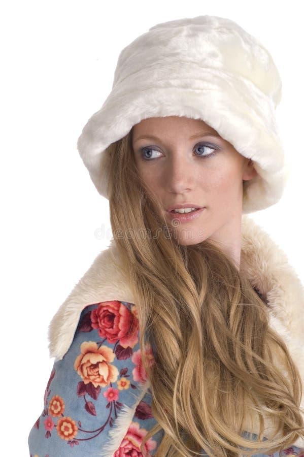 Frau, die über Schulter schaut lizenzfreie stockfotos