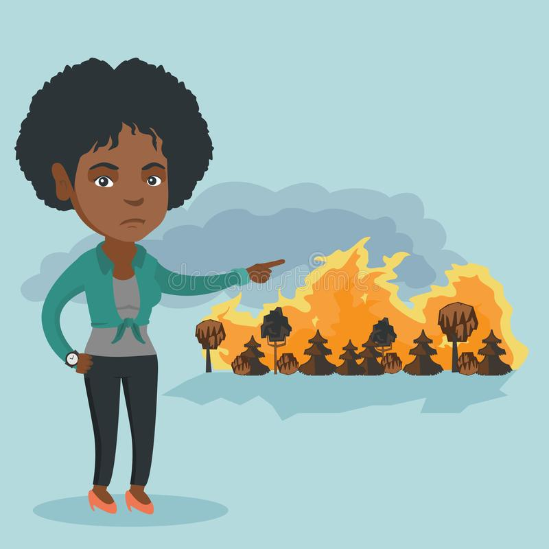 Frau, die auf dem Hintergrund des verheerenden Feuers steht lizenzfreie abbildung