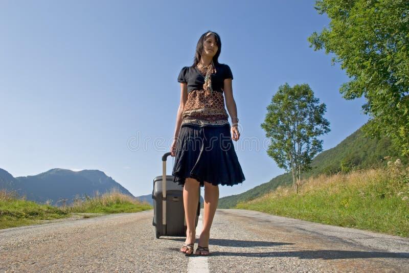 Frau, die auf einer Reise verlässt stockbild