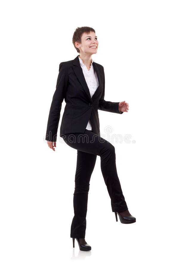 Frau, die auf eingebildeten Jobstepp tritt stockfotografie