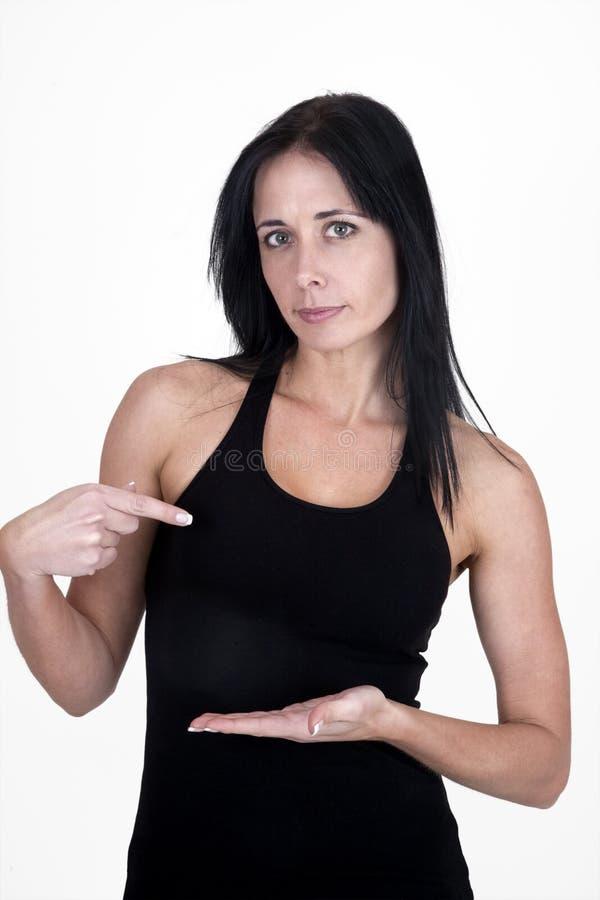 Frau, die auf ihre Hand zeigt lizenzfreies stockbild