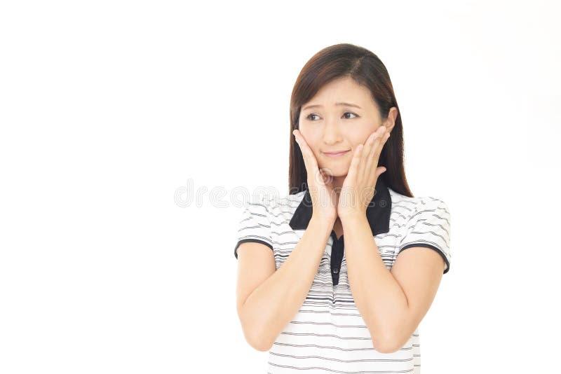 Frau, die besorgt ist lizenzfreies stockfoto