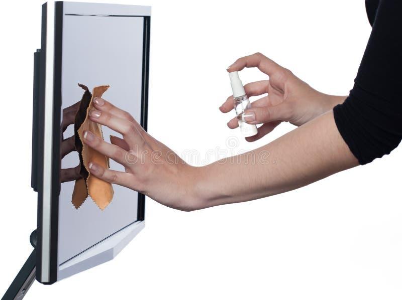 Frau, die Bildschirm abwischt lizenzfreie stockbilder