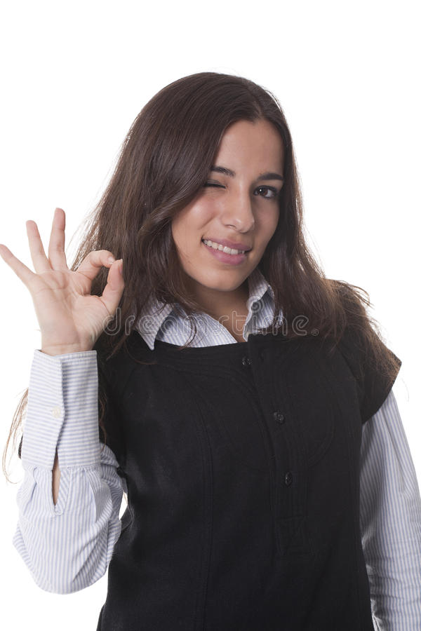 Frau, die Daumen und Blinkenauge aufgibt lizenzfreie stockfotos