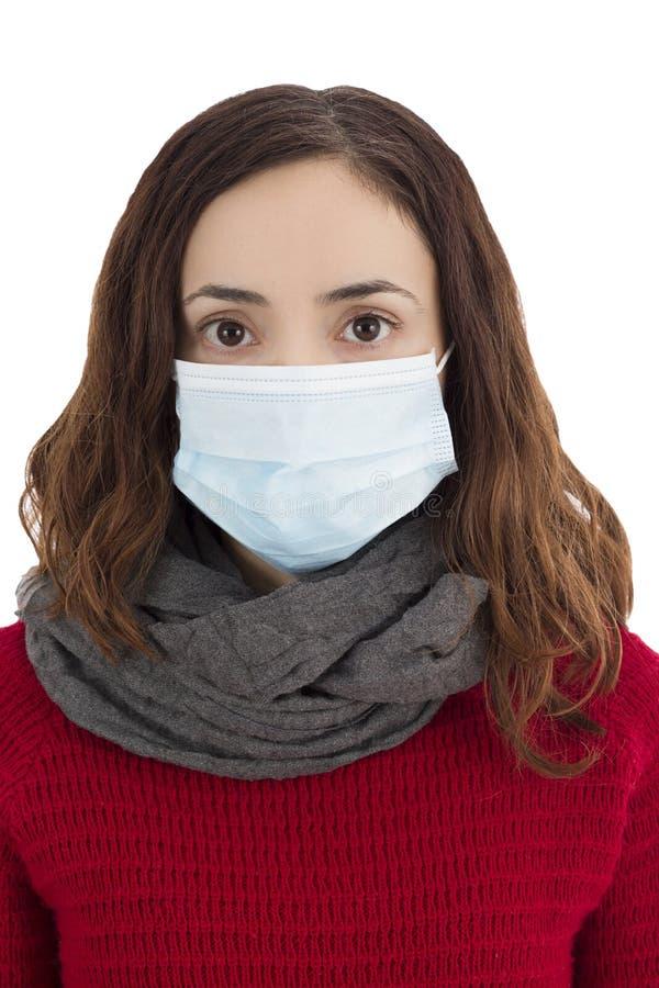 Frau, die eine Virusmaske trägt stockfotos