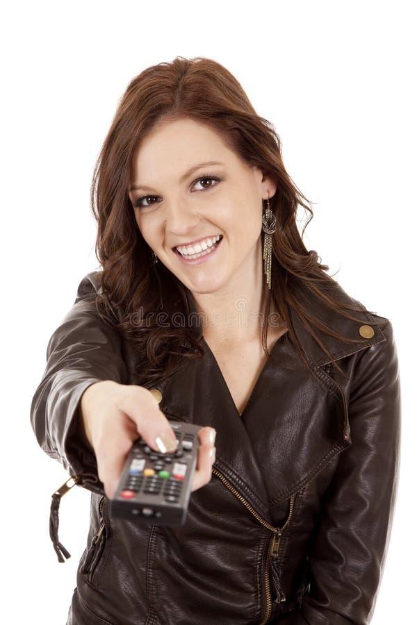 Frau, die Fernlächeln zeigt lizenzfreie stockbilder