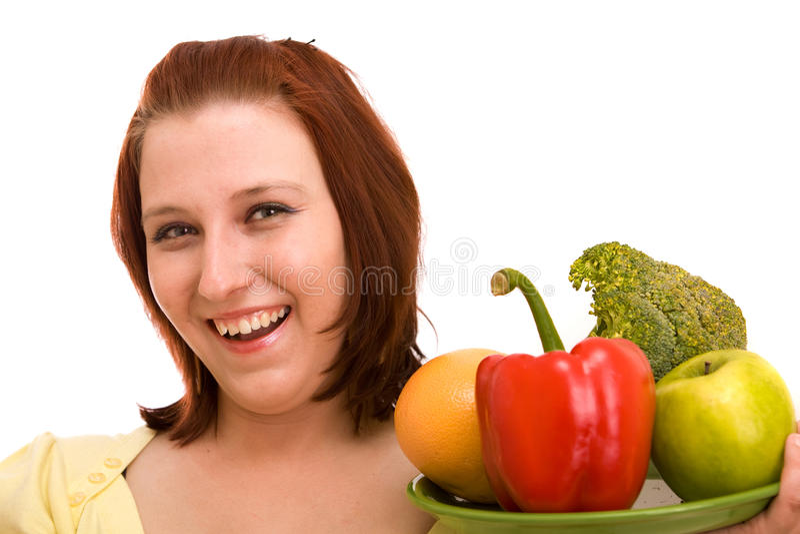 Frau, die Gemüse isst stockfoto