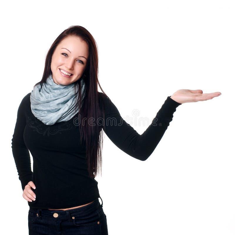 Frau, die heraus ihre Hand anhält stockbild