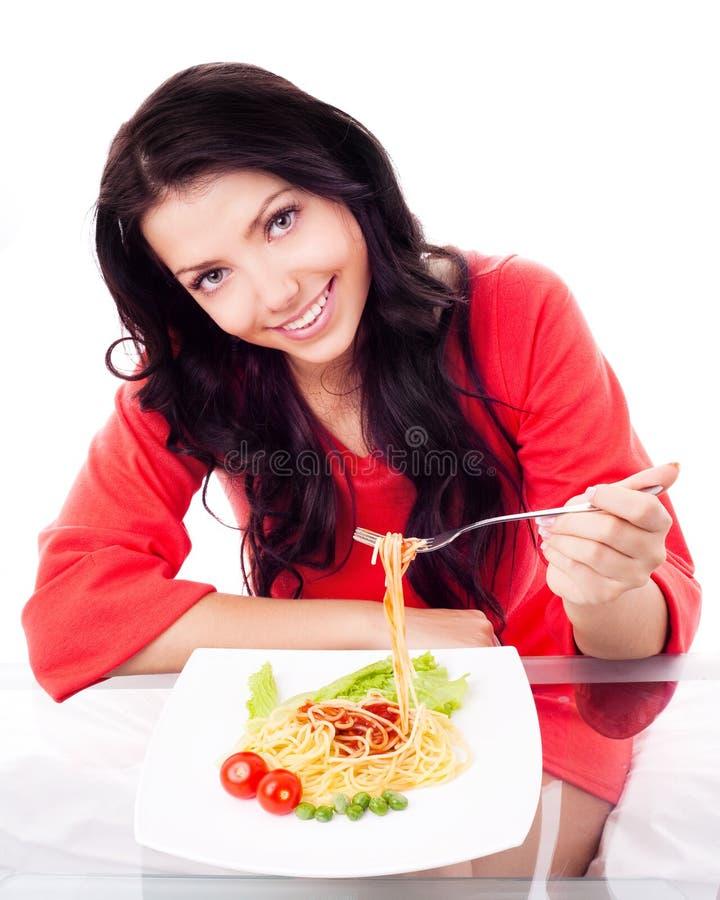Frau, die Isolationsschlauch isst lizenzfreie stockbilder