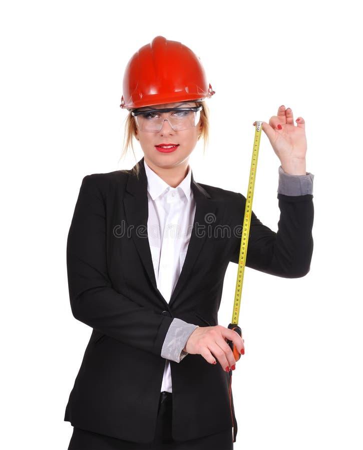 Frau, die Maßband hält lizenzfreies stockbild