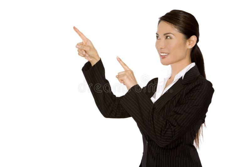 Frau, die mit den Fingern zeigt stockbild