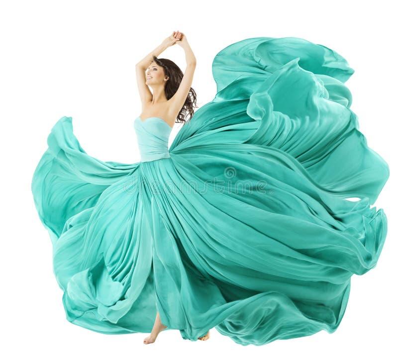Frau, die in Mode Kleid, Gewebe-Stoff wellenartig bewegt auf Wind tanzt stockbilder