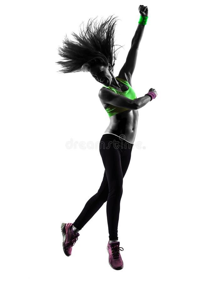 Frau, die springendes Schattenbild Eignung zumba Tanzens ausübt stockbilder