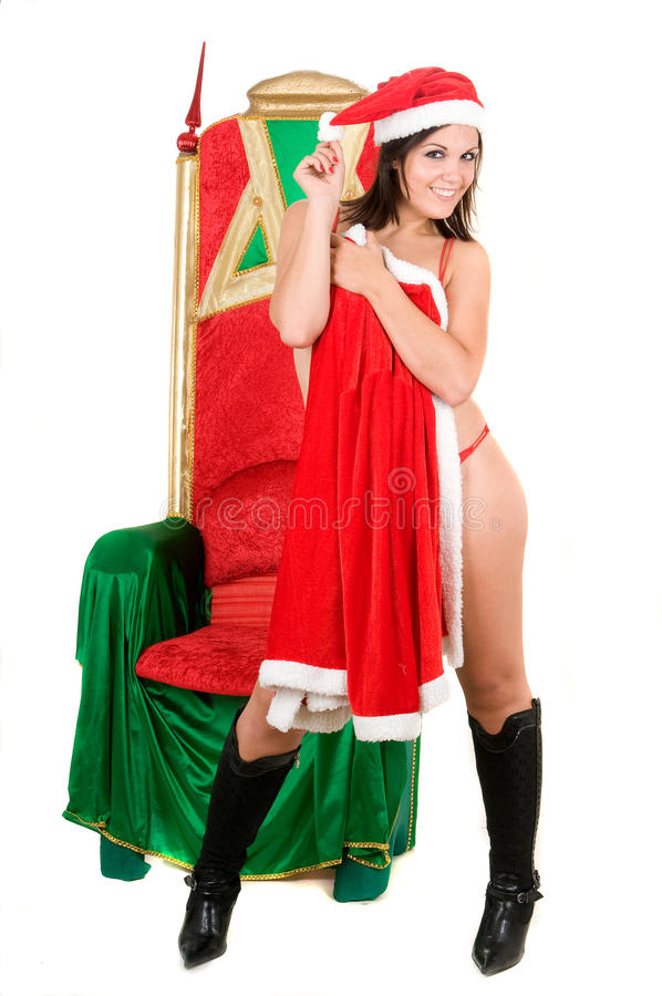 Frau, die Weihnachtsmannkleidung und -c$trinken trägt lizenzfreies stockbild