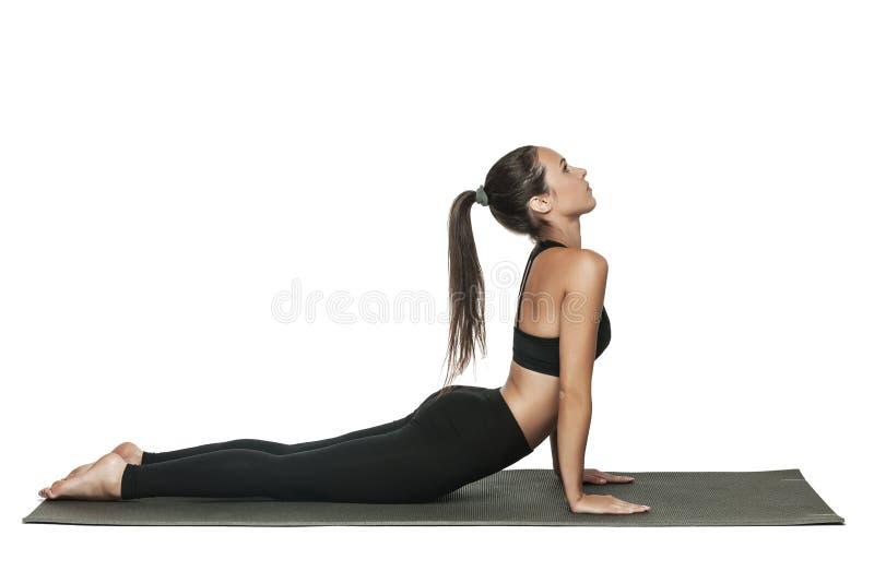 Frau, die Yoga tut Lokalisiert auf Weiß lizenzfreies stockfoto