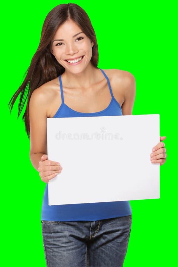 Frau, die Zeichen zeigt stockfotografie