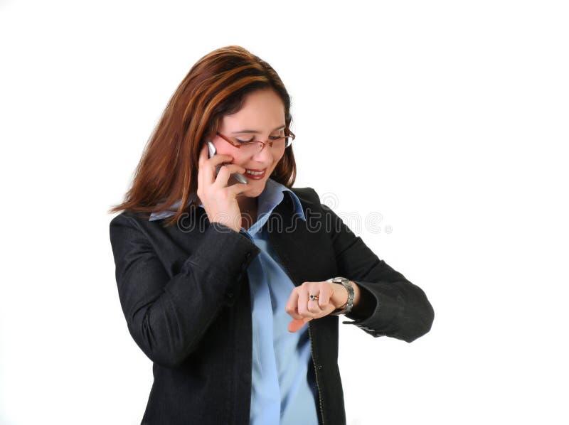 Frau an einem Telefon stockfotos
