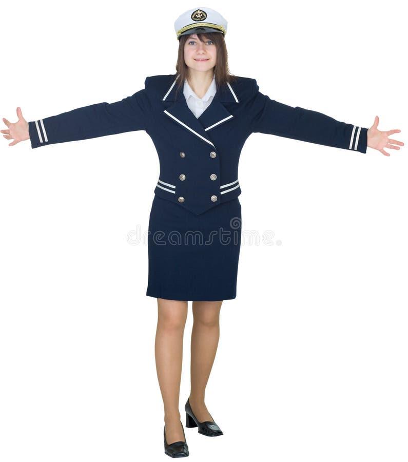 Frau in einer Uniform des Matrosen zeigt ausgedehntes lizenzfreie stockfotos
