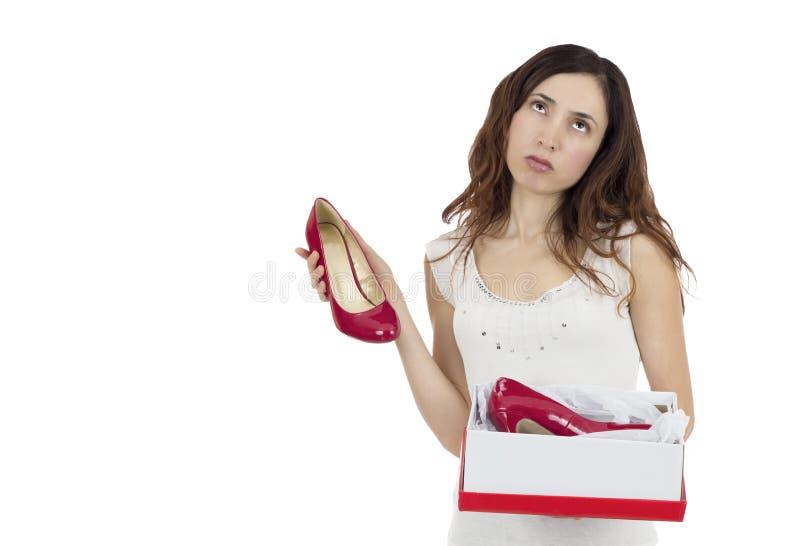 Frau enttäuscht über ihr Geschenk stockfotografie