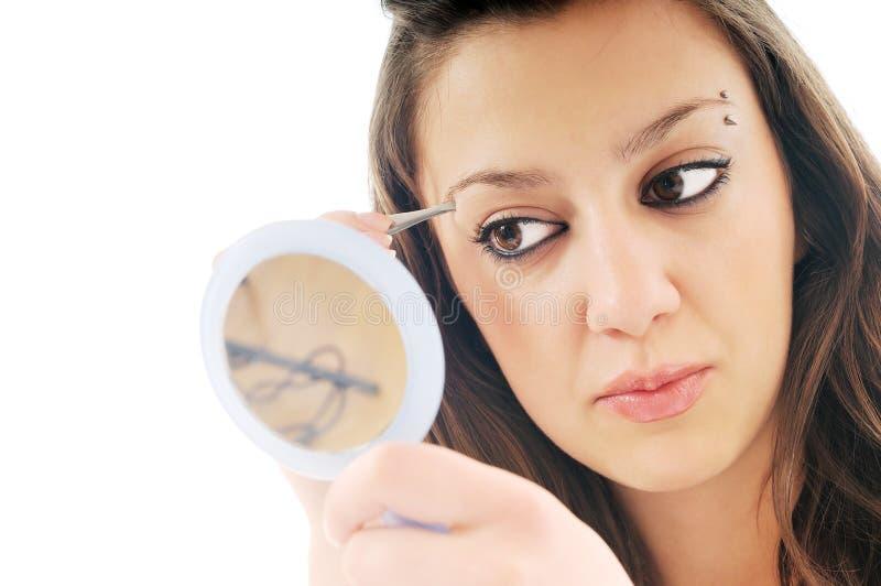 Frau getrennte Augenbraueschönheitsbehandlung stockfotografie
