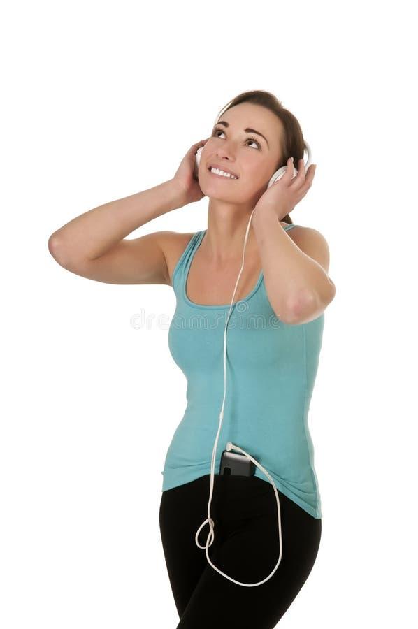 Frau hört Musik stockfotos