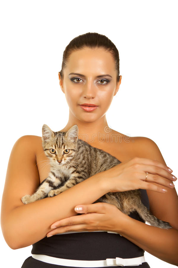 Frau halten ihre reizende Katze stockbild