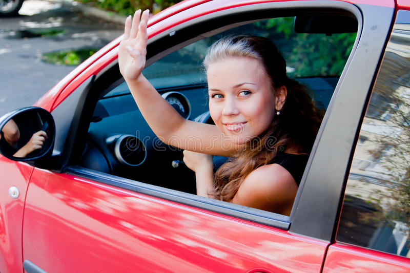 Frau im Auto stockbilder