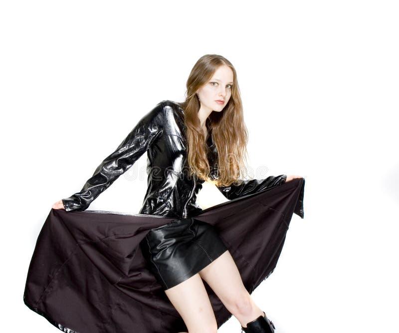 Frau im festen Leder stockbild