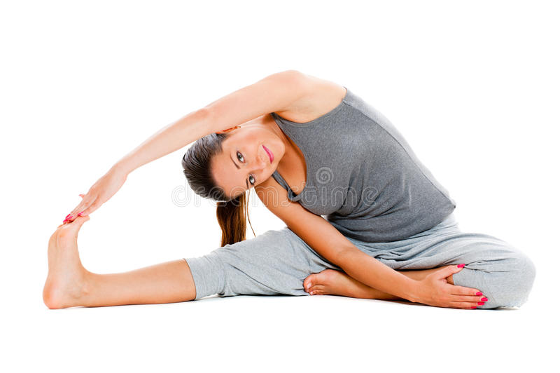 Frau im grauen Sportkleidungtraining stockbild