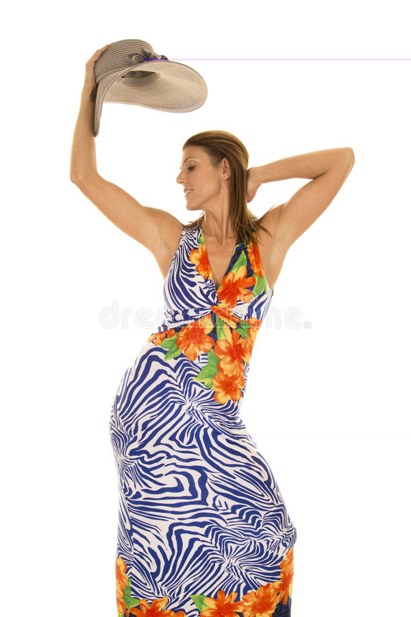 Frau im hawaiin Kleidergriffhut obenliegend stockbild