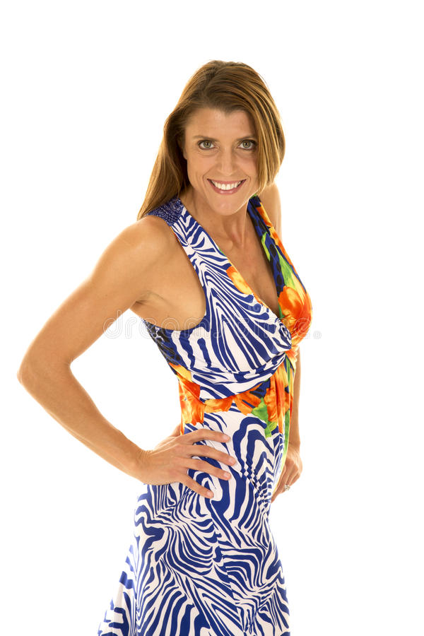 Frau im hawaiin Kleiderseitenblick stockbilder