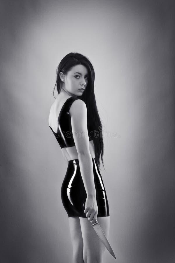 Frau im Latex stockfotos