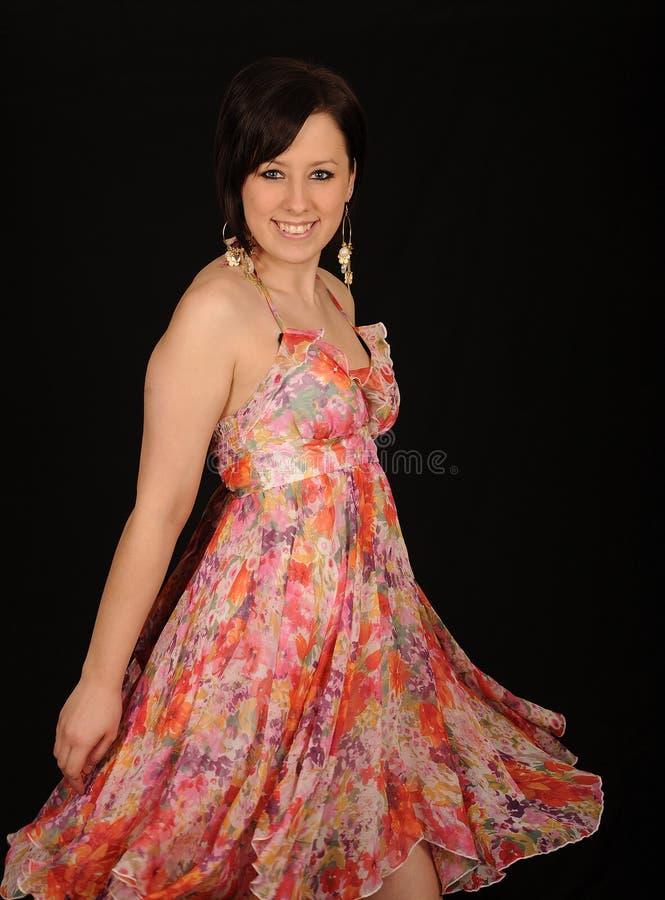 Frau im Partykleid stockbilder
