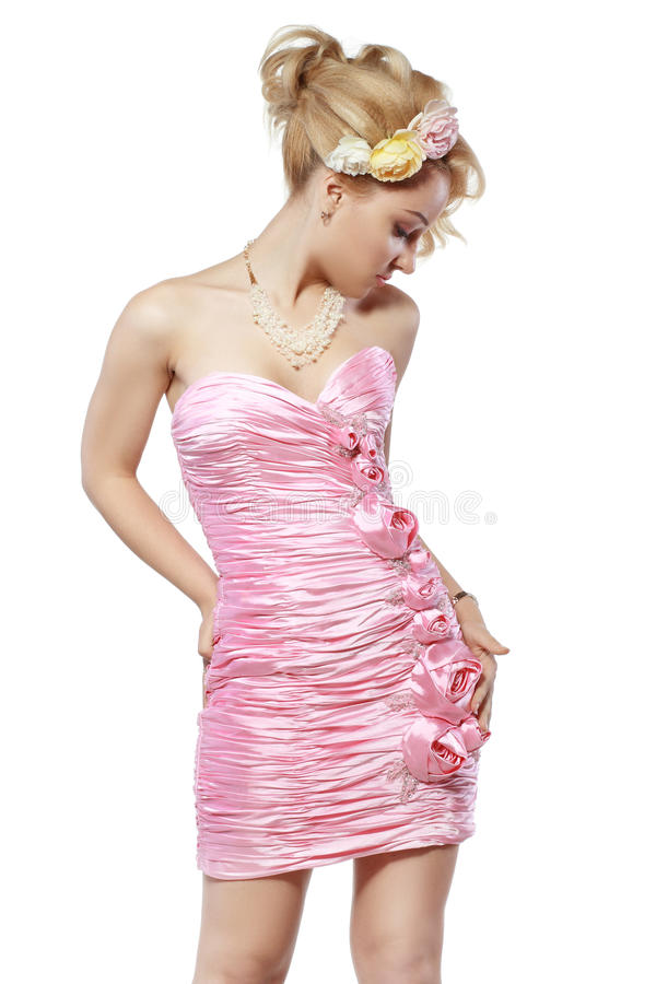Frau im rosafarbenen Kleid lizenzfreies stockfoto