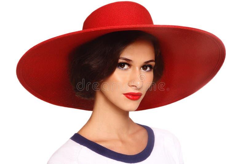 Frau im roten Hut stockbilder
