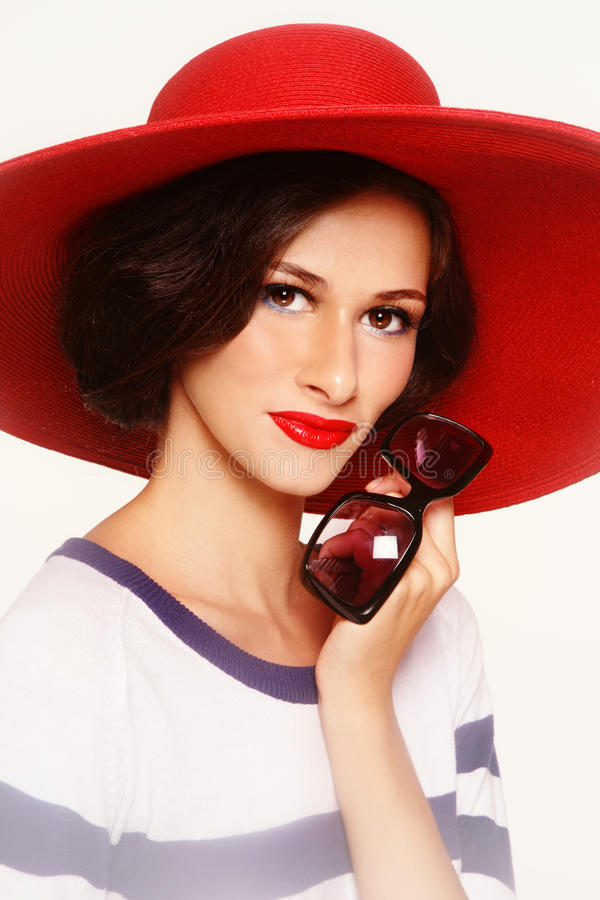 Frau im roten Hut lizenzfreies stockfoto