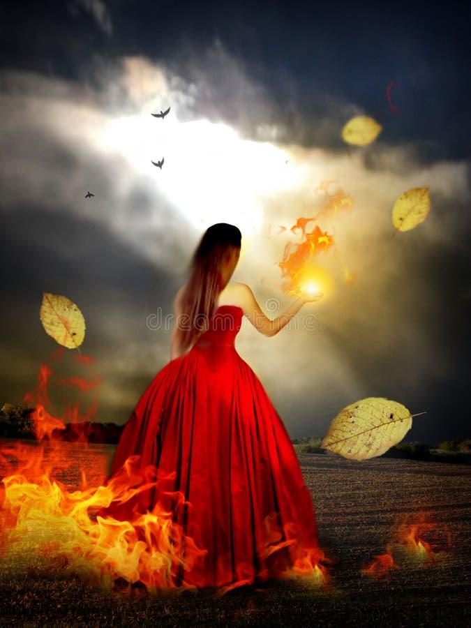 Frau im roten Kleid mit magischem Feuer lizenzfreie stockbilder