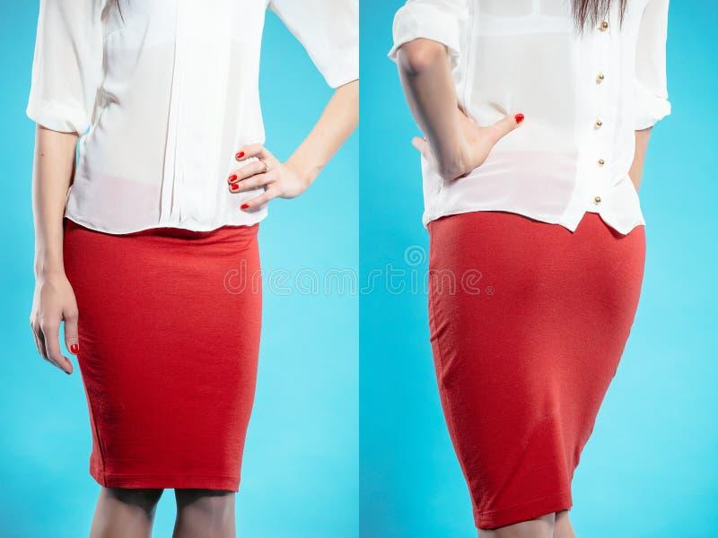 Frau im roten Rock lizenzfreies stockbild
