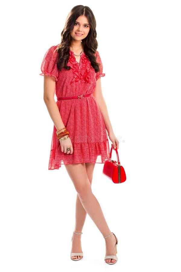 Frau im roten Sommerkleid lizenzfreies stockbild