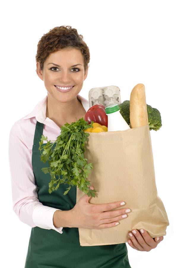 Frau im Vorfeldholding-Lebensmittelgeschäftbeutel stockbilder