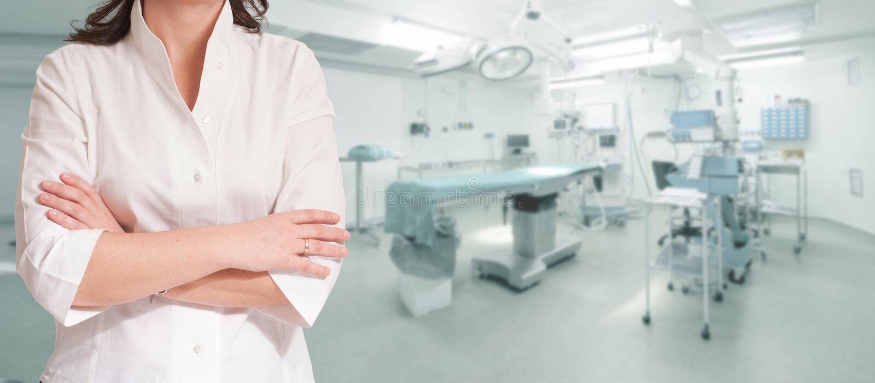 Frau im Weiß im Operationsraum stockbilder