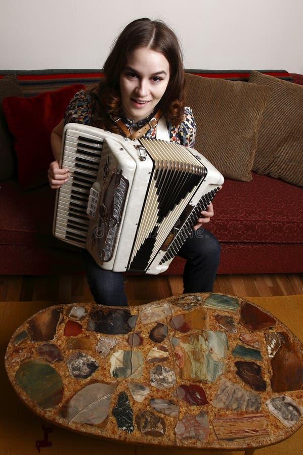 Frau mit accordian stockbilder