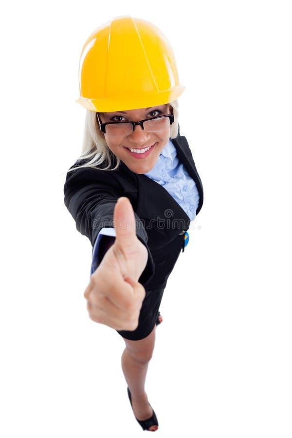 Frau mit anerkennend Arbeit des Sturzhelms stockfotos